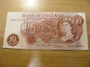 A Ten Shillings Banknote J Hollom 86N 130189, Used folds but still crisp