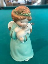 Vintage 70's or 8o's porcelain Angel bell holding a bunny or lamb