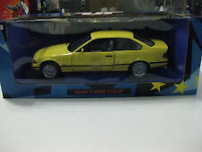 1/18 scale UT Models BMW M3 E36 Serie Coupe in Dakar Yellow New in box