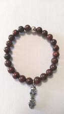 Men's Red Tiger Eye Stone Beaded  Bracelet With Sterling Silver Skull Pendant.