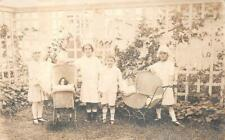 RPPC CHILDREN WITH DOLLS IN BABY CARRIAGES REAL PHOTO POSTCARD (c. 1910)