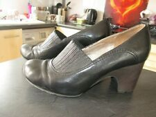 Size 7 Black slip on shoes by CLARKS