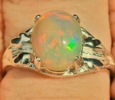 Solid ETHIOPIAN WELO OPAL 10x8mm Oval 925 Sterling Silver Ring Size 7.5