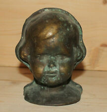 Antique hand made wall hanging solid bronze child head figurine