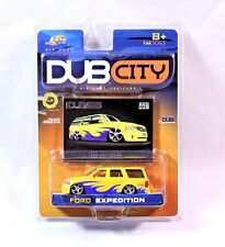 JADA TOYS~DUB CITY~FORD EXPEDITION~DIECAST VEHICLES~YELLOW W/ PURPLE WAVES