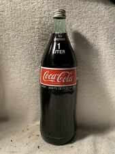 FULL 1 LITER COCA-COLA SMALL MOUTH ACL SODA BOTTLE RETURN FOR DEPOSIT