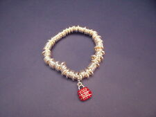 New Stretch Bracelet of Silver Coloured Beads & Red Enamel Handbag Charm
