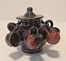 Miniature ceramic jug with lid and 6 hanging mugs.
