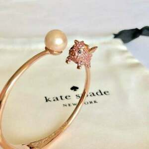NWT Kate Spade Decorated with winged crystal-studded pig rose gold Bracelet