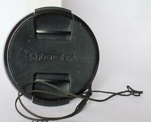 Sony Cybershot 55mm centre pinch front lens cap with retaining cord.