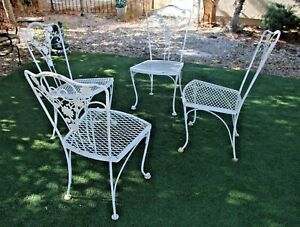Very Pretty four solid hand bent Iron chairs French country garden art deco base