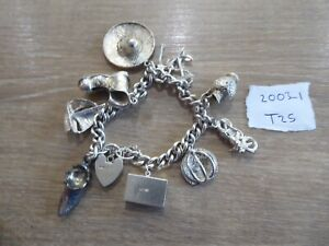 BEAUTIFUL VINTAGE SOLID SILVER CHARM BRACELET WITH 11 CHARMS