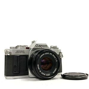 Canon AV-1 Silver SLR Film Camera Body / NFD New FD 50mm f/2 Lens - GOOD