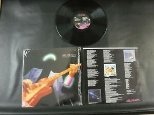 1988 DIRE STRAITS  MONEY FOR NOTHING  W1-25794  RECORD IN SHRINK  Excellent