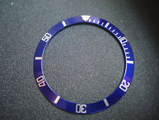 A BETTER OLD SUBMARINER STYLE OF BLUE ALUMINUM BEZEL INSERT WITH SILVER NUMBERS