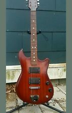 Defil Tosca electric solid body redwood finish guitar