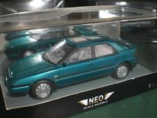 Neo 43637 - Mazda 323 F turquoise met - 1:43 Made in China