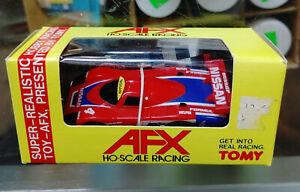 TOMY AFX HO SLOT CAR NISSAN DUNLOP CASTROL #4