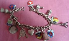 1950s Solid Silver Charm Bracelet with 16 Charms 30 grams