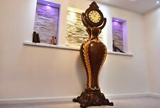 Elegant Rococo Mora style Grandfather clock with hand Gilded curvaceous body