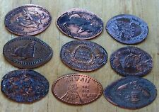 9 elongated coins: one from Hawaii and 8 from New York Aquarium