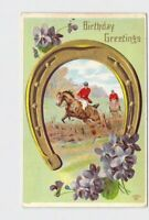 ANTIQUE POSTCARD BIRTHDAY GREETINGS HORSE BACK RIDING SHOE FLOWERS GOLD EMBOSSED