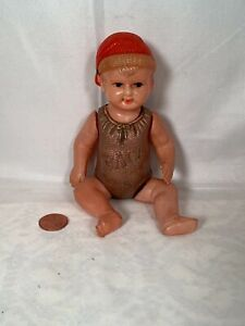 """VINTAGE JAPAN JOINTED 6"""" CELLULOID BABY DOLL RED CAP AND GREEN ONE PIECE """"RACE"""""""