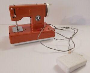 Vintage Casige Orange Child Sewing Machine Toy
