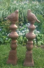 Two charming terracotta garden ornaments of native birds on columns 2ft tall