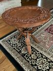 an antique handcrafted side table bought in Thailand