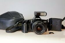 MINOLTA DYNAX 3000i + Zoom MINOLTA AF 35-80mm + Flash 314i + étui. Exc+