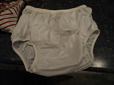 ADULT.    WHITE,  PVC.  PULL ON PANTS , MED ,  WAIST 27-37in