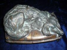 Bronze reclining dog sculpture