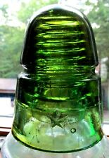 New ListingBeehive shape Yellow / Green Glass Insulator Marked with a Large Star