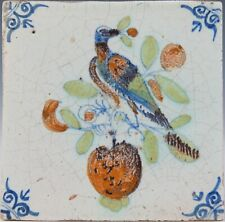Nice Dutch Delft polychrome tile, bird and apple, mid 17th. century.