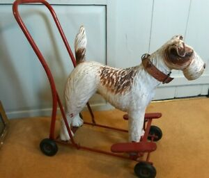 Rare vintage fox terrier Triang dog on wheels 1950s