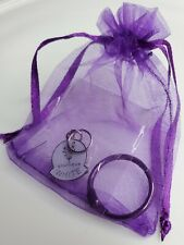 Younique White Presenter Charm with Purple Ring and mesh bag.  New in package.