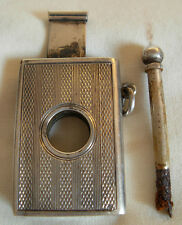 OLD 800 GERMAN SILVER CIGAR CUTTER COMBINED WITH MATCH STRIKE PENDANT