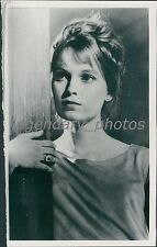 Shot of Actress Mia Farrow Holding Pillar Original News Service Photo