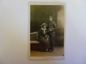 sepia postcard of a portrait of a WW1 soldier from RAMC with a lady