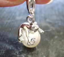 Clip on Charm - Silver plated frog sitting on cream pearl