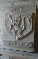Stone carving of coat of arms in sandstone also date stone