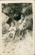 Young girl & boy smoking pipe seaside sand 'Daily Mail' buckets QR141