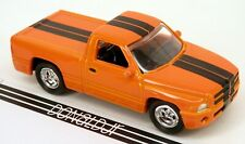 Johnny Lightning 1990s Dodge Ram Pickup Truck Orange 1/64 Scale Diecast