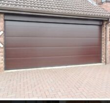 PLAIN SECTIONAL GARAGE DOOR FULLY SEALED NOT UP AND OVER CALL NOW 01543578899