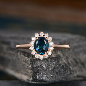 2.50 Ct Oval Cut London Blue Topaz Halo Engagement Ring 14K Yellow Gold Over