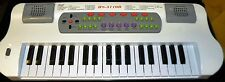 Electric piano miniture keyboard 37 keys with sounds and auto rhythms white