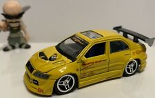 LOOSE MUSCLE MACHINES MITSUBISHI EVO VII SS TUNER IMPORT PACIFIC RIM YELLOW 1/64