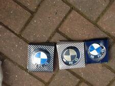 Job lot of three BMW Car badges in presentation boxes.