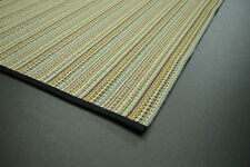 Multi color striped flat weave wool rug edged in black cotton tape